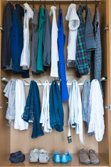 Wardrobe with clothing and shoes.