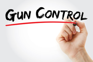 Hand writing Gun control with marker, concept background