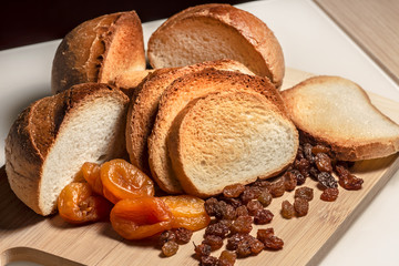Sliced / baked bread and dried fruits / crackers / hard chuck