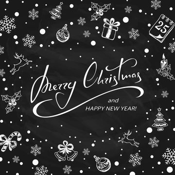 Merry Christmas with decorations on black chalkboard background