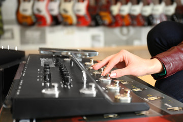 Female hand on audio control panel