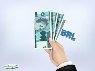 brazilian reals money paper on hand,cash on hand