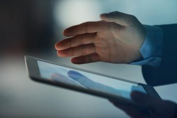 Businessman holding modern tablet, closeup