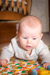 Baby with blue eyes crawling