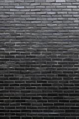vertical part of wall consisting of black bricks