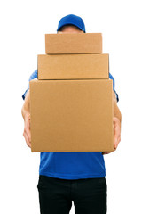 delivery man holding pile of cardboard boxes in front