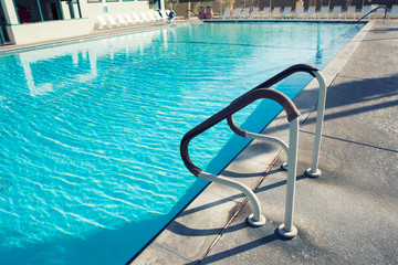 Grab bars ladder in the swimming pool.