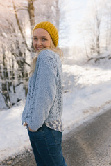 Beautiful young woman in her winter warm clothing. Happy woman h