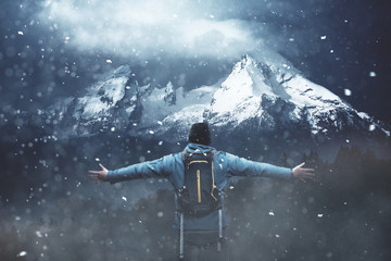 Wall Mural - Hiker in the snow with raised hands