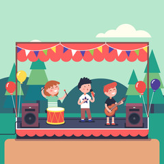 Kids music band playing at public park festival