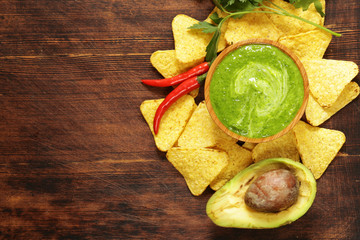 Natural fresh guacamole dip with avocado and corn chips