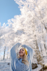 portrait of adventure woman in winter mountain  background