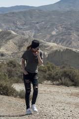 Trendy woman walking in desert