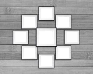 Collage of nine blank photo frames on grey wooden panels wall