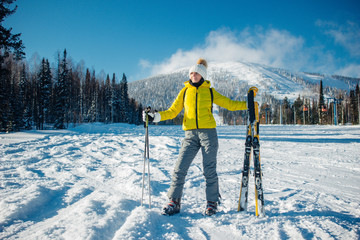Beautiful young sport woman in yellow grey winter clothes stands