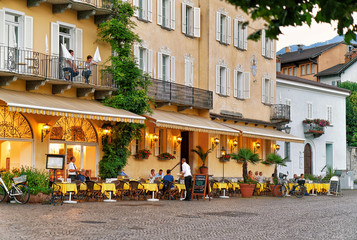 People relaxing at Street Restaurant in Ascona in Swiss