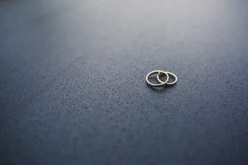 engagement rings on a plain surface