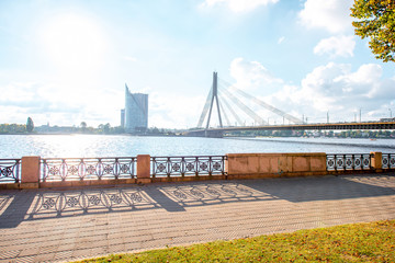 View on the promenade with river and bridge in Riga city, Latvia