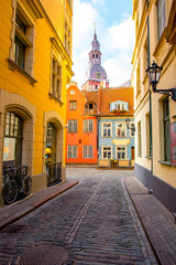 Printed roller blinds Eastern Europe Street view with bell tower of Dome church in the old town of Riga city, Latvia