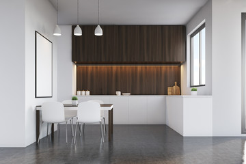 Kitchen with dark wood furniture and poster
