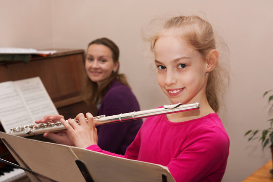 girl, teacher and flute, piano
