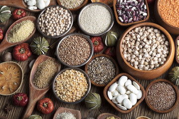 Healthy food and diet theme. Lentils, peas, beans, protein food in bowls, on a wooden table.