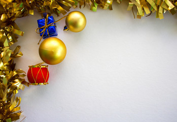 Christmas ornament flat composition with white board. Golden ribbon with fir tree ornament.
