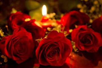 Red roses with a candle