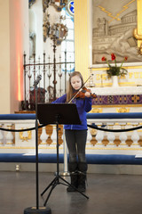 Sweden, Girl playing violin (8-9) on stage