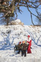 Sweden, Blekinge, Solvesborg, Mother giving hot drink to daughters (8-9, 10-11, 12-13)