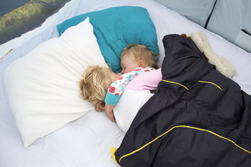 Sweden, Two sisters (2-3, 4-5) sleeping in tent