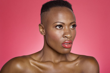 Close up of serious African American woman over colored background