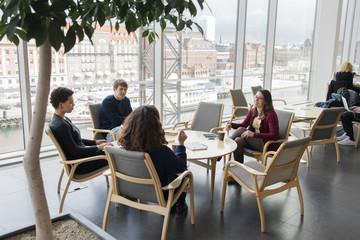Sweden, People talking in library