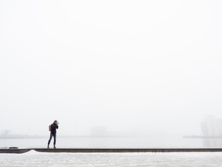 Sweden, Skane, Malmo, Man taking photo on pier