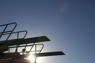 Silhouette of a springboard against clear sky