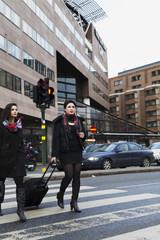 Sweden, Stockholm, Women crossing street