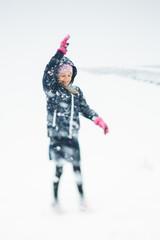 Sweden, Blekinge, Girl (10-11) playing in snow