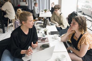 Sweden, Women talking in cafe