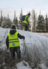 Volunteers rescuing on snow covered landscape
