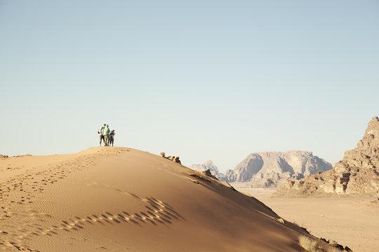 Jordan, Wadirum, People standing on sand dune