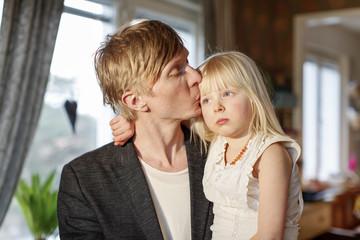 Sweden Portrait of man kissing daughter (4-5)