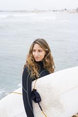 Israel, Tel Aviv, Woman with surfboard