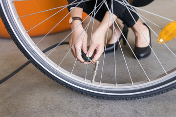 Sweden, Close-up of human hand pumping bicycle wheel