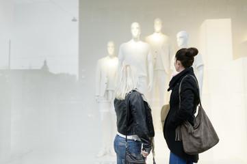 Sweden, Mid adult women window shopping