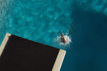 High angle view of legs of a swimmer diving in pool