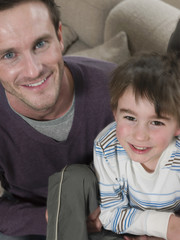 High angle portrait of happy father and son at home