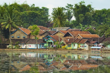 Traditional homes and Situ Cangkuang lake at this village known for its Hindu temple, Kampung Pulo, Garut, West Java, Indonesia, Southeast Asia, Asia