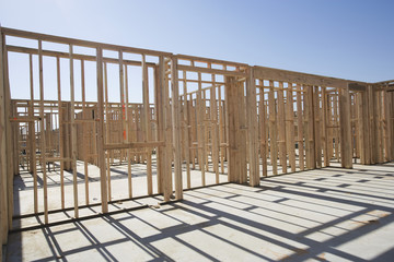 Wooden frame of house at construction site