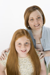 High angle view of mother and daughter isolated over white background