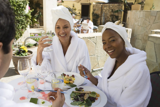 Portrait of an African American woman eating organic meal with friends